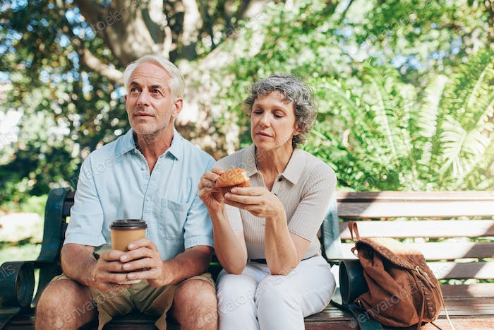 Senior couple sitting outdoors on a park