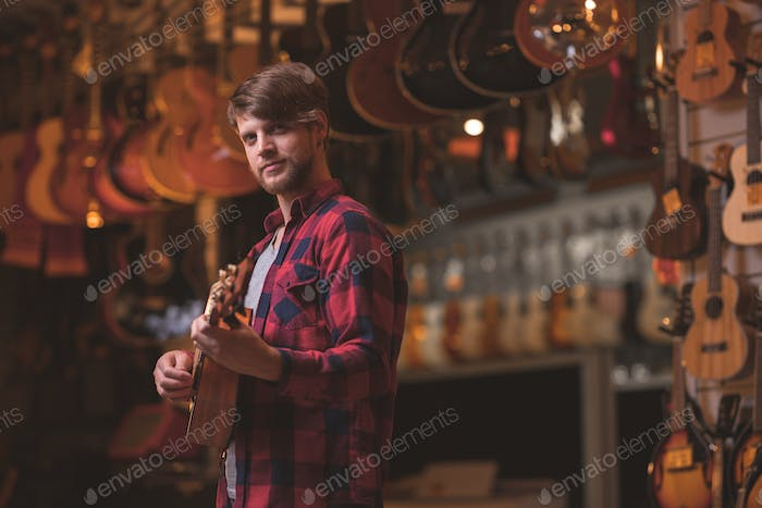 Young musician with a ukulele