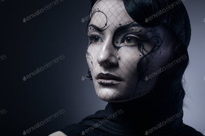 portrait of young gothic woman isolated on dark background with copyspace
