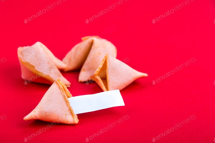 Fortune cookies with blank predictive label on red background