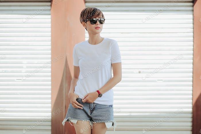 Short Hair Asian Girl wearing white tshirt and sunglass