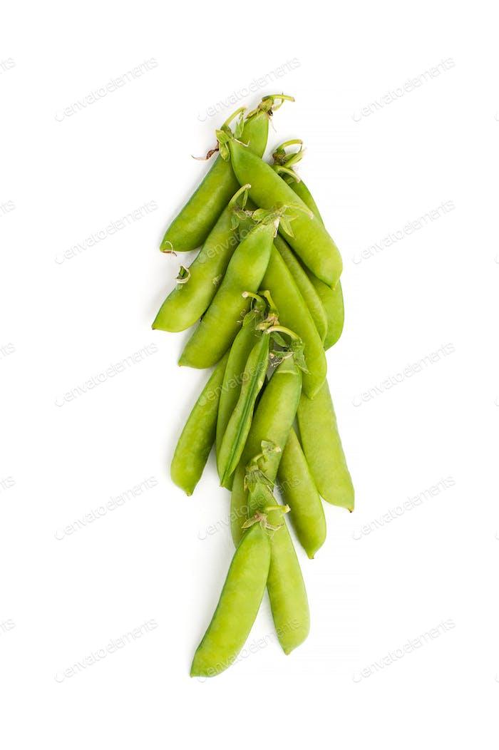Young green stiletto peas on a white background.