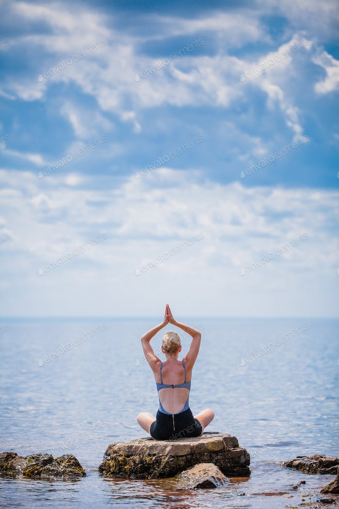 Young Woman doing Lotus Yoga Position