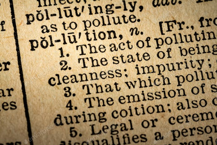 Close-up of the word POLLUTION and its definition