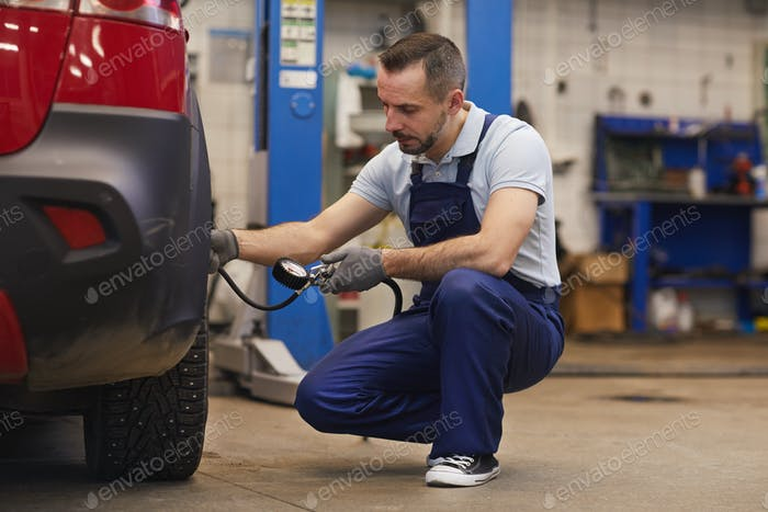Mechanic Pumping Tires