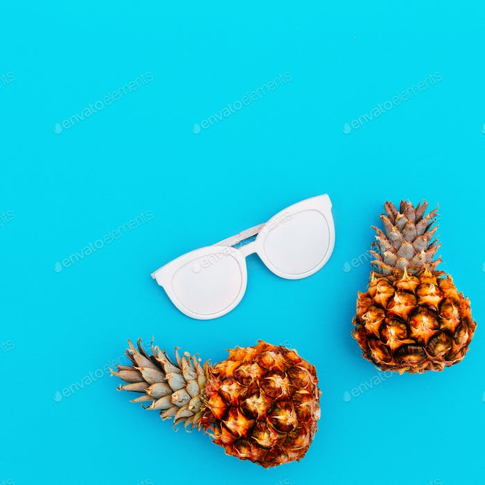Sunglasses and pineapples. Fashion accessory of the summer.