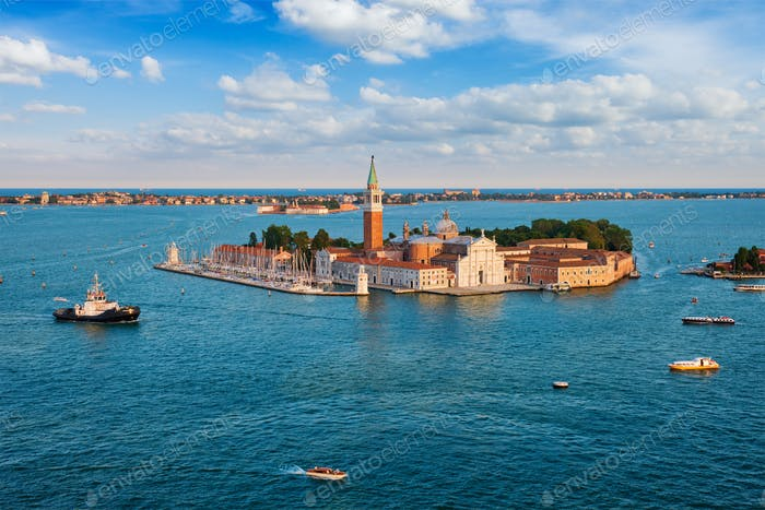 Aerial view of Venice lagoon with boats and San Giorgio di Maggiore church. Venice, Italy