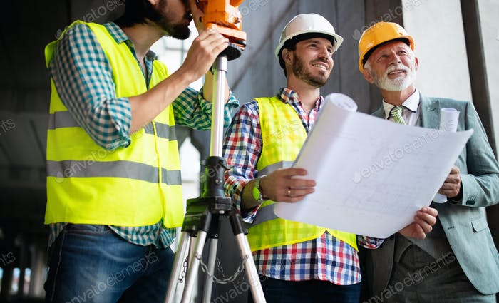 Construction engineer with foreman worker checking construction site