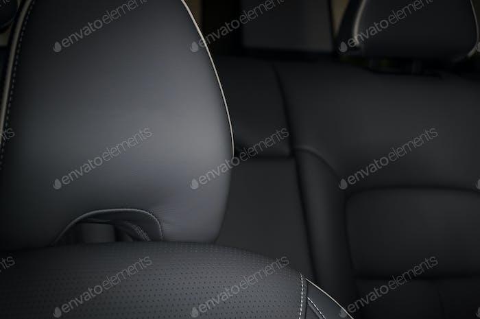 Modern sport car  black leather interior. Part of  leather car seat details.