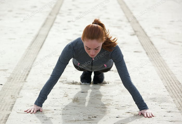 Woman doing pushing ups