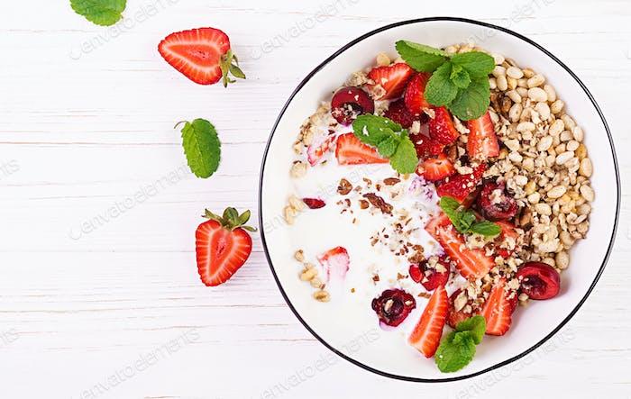 Thumbnail for Healthy breakfast - granola, strawberries, cherry, honeysuckle berry, nuts and yogurt