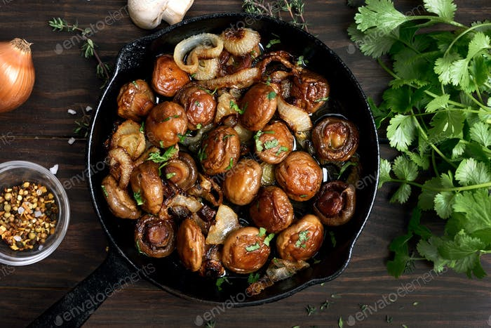 Cooked mushrooms in cast iron pan