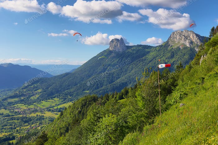 Ppeople doing paragliding from Col du Forclaz, France