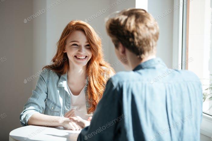Young woman laughing in cafe