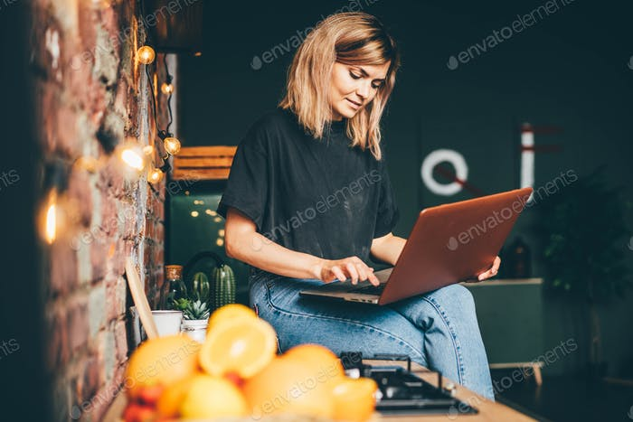 Woman types on laptop