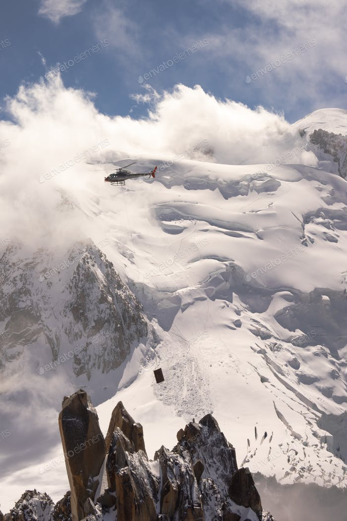 Helicopter flying in the Alps