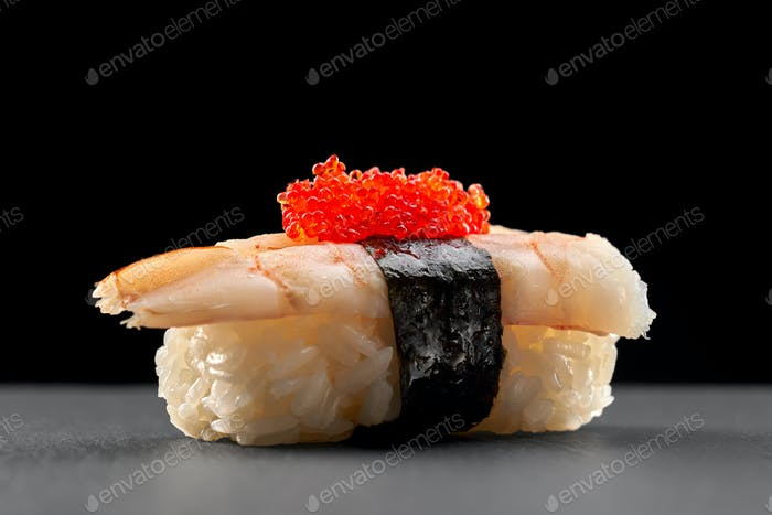 Ebi nigiri topped with red flying fish roe