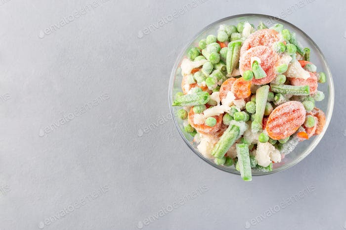 Bowl with frozen vegetables, horizontal, copy space, top view