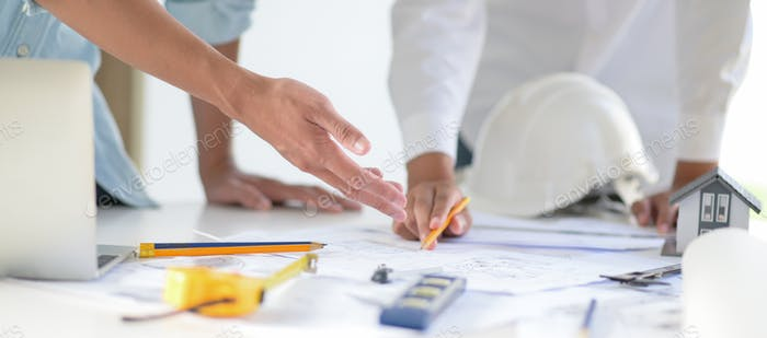 Designers and architects collaborate on designs for new construction projects.