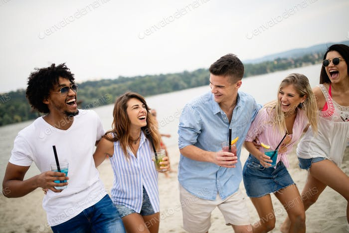 Happy people having fun in summer holidays. Friends, vacation, summer lifestyle and youth concept