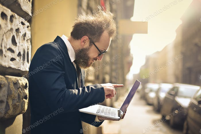 Man with a laptop outdoor