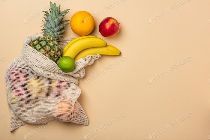 Reusable Eco Friendly Shopping Bag With Fruits. Border Background with Copy Space