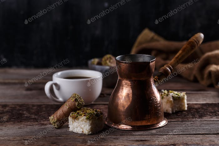 Traditional turkish coffee and turkish delight on dark wooden backgroundm copy space
