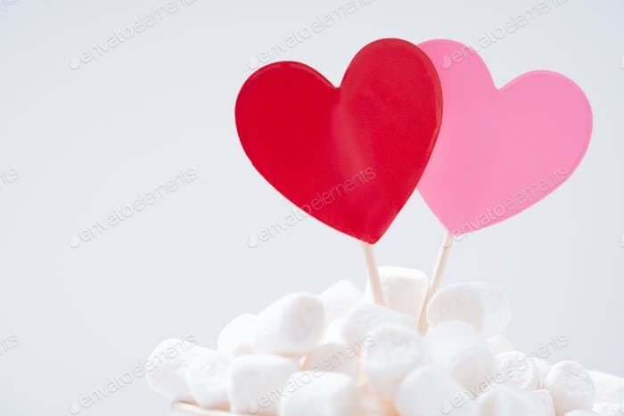 Red and pink hearts in marshmallow on white background