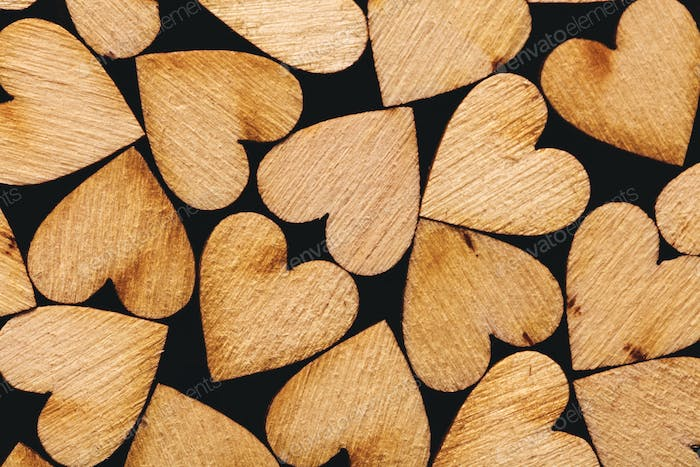 Wooden hearts laying together tightly