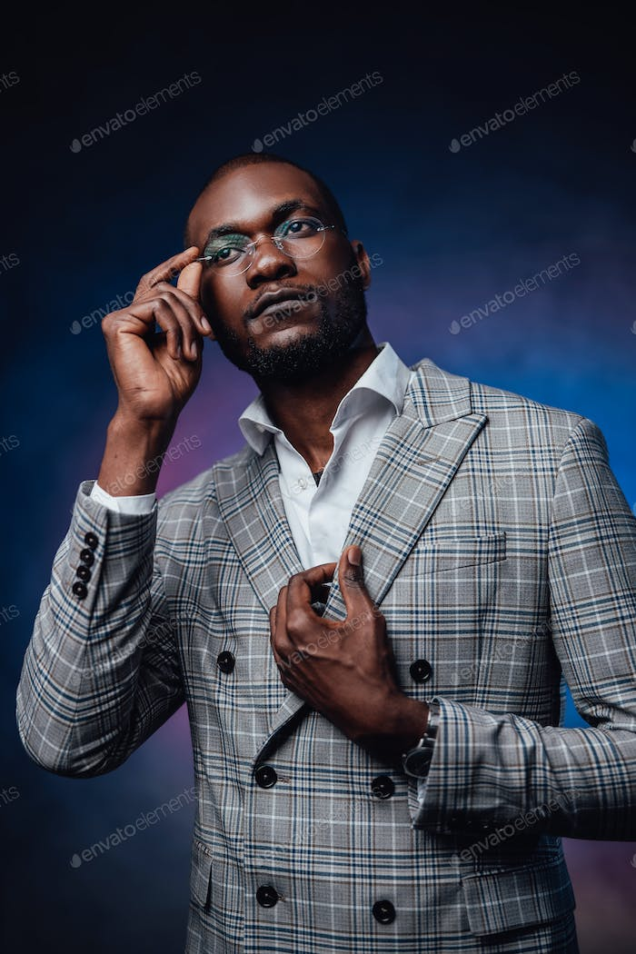 An african man with fashionable custom suit
