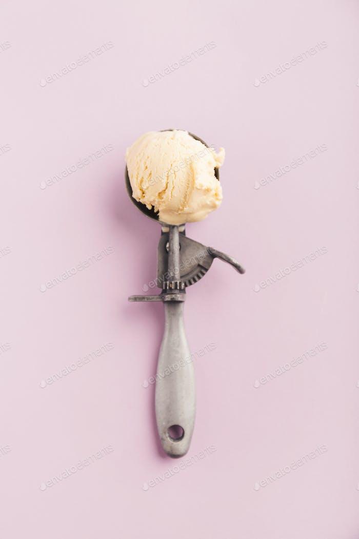 Vanilla ice cream in vintage old metal spoon