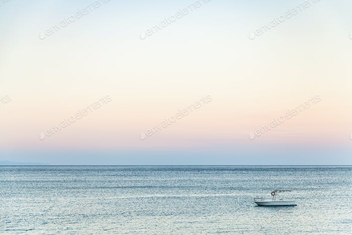 view of boat in Ionian sea in summer evening