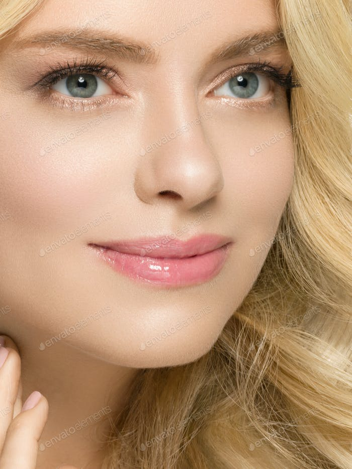 Beautiful woman face with curly long blond hair beauty portrait