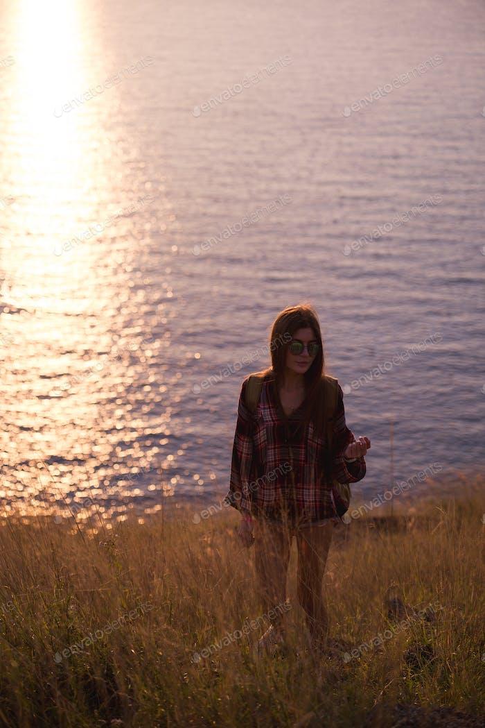 young freedom woman enjoy ocean sunset on mountain peak