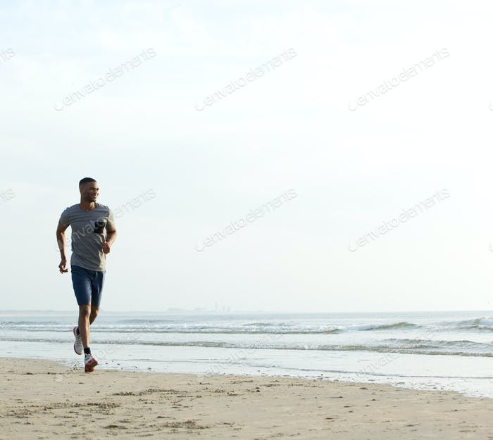 Young fit african american man running