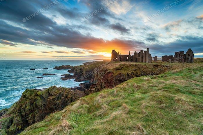 Dramatic sunset over the ruins Slains Castle