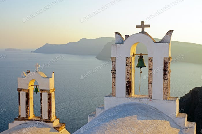 Belltowers at sunset in Oia