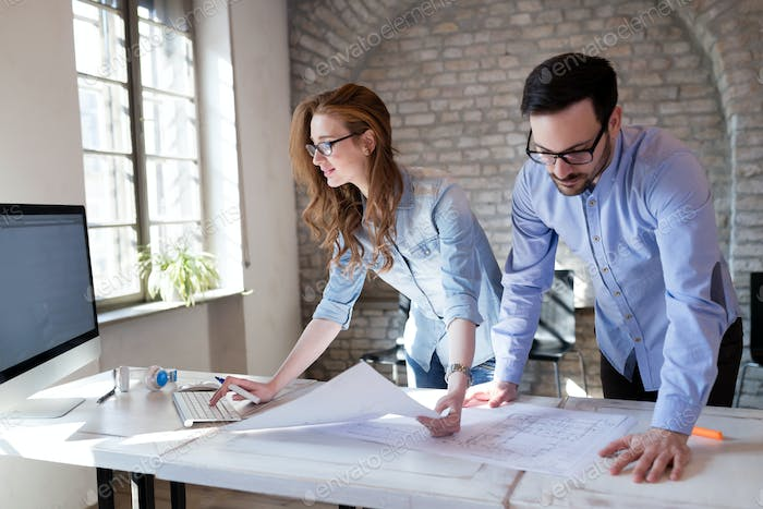 Coworking process, designers team working in modern office