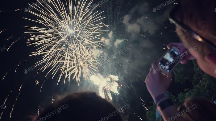 Woman enjoying fireworks celebration