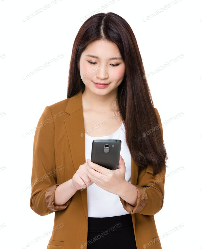Young businesswoman use of the smartphone