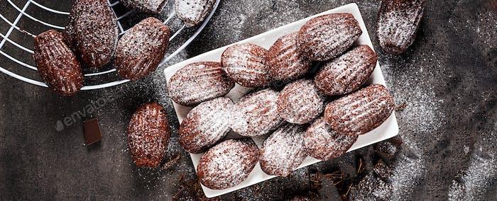 Chocolate cookies. Homemade Chocolate Madeleines on dark table.