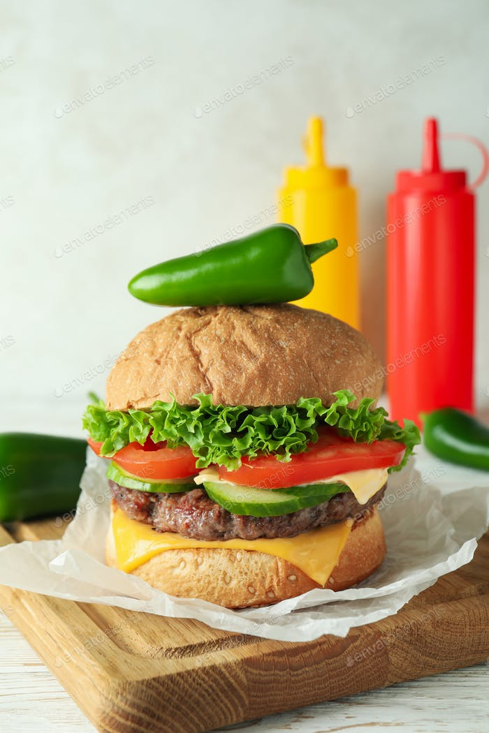Concept of tasty food with delicious burger