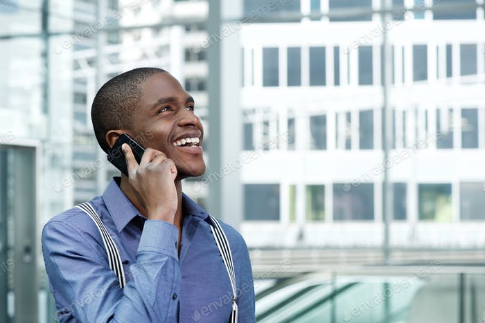 smiling african american businessman using cellphone