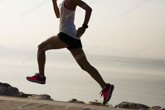Running on sunrise seaside