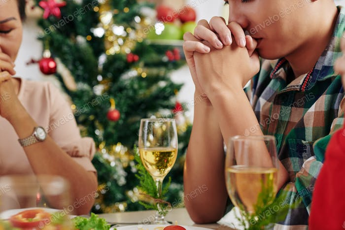 People praying before dinner
