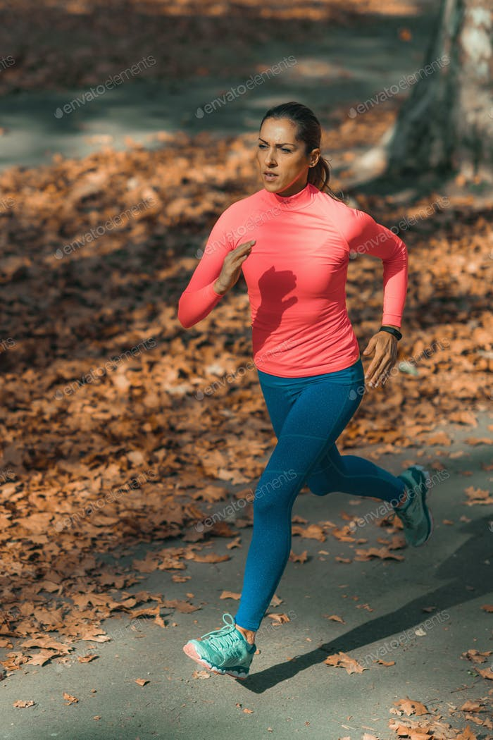 Woman Jogging Outdoors in Park