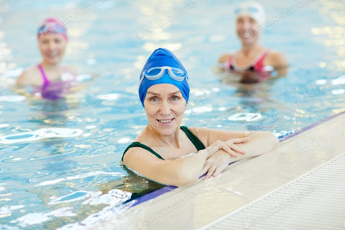 Smiling Adult Woman Posing in Pool