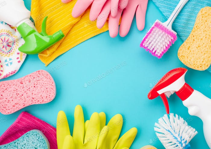 Detergents and cleaning accessories in pastel color. Cleaning service, small business idea. Top view
