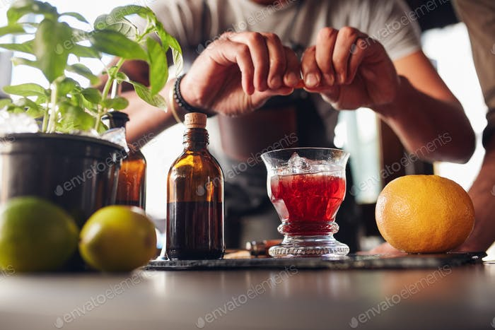 Bartender preparing negroni cocktail