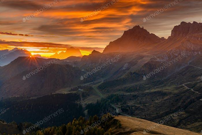 Misty sunrise at Pass Pordoi. Dolomites mountains, Italy